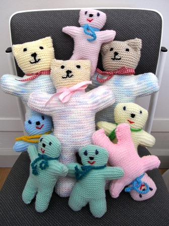 group of small and large knitted bears